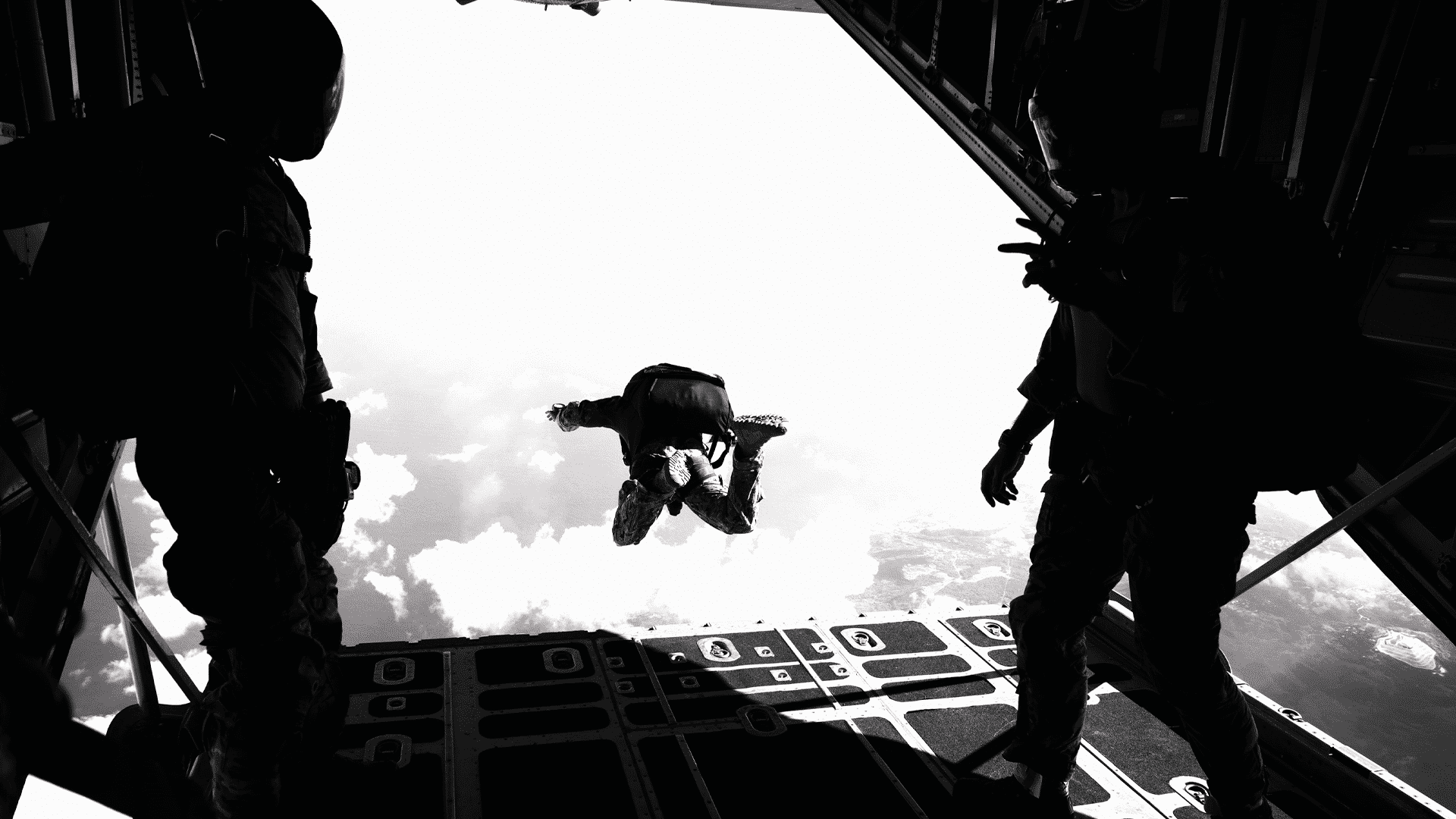 U.S. Navy sailors jump from a C-130 Hercules aircraft during military free fall jump sustainment training near Santa Rita, Guam, Oct. 14, 2015. The sailors are assigned to Explosive Ordnance Disposal Mobile Unit 5.
